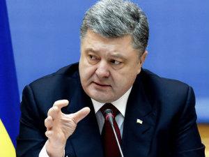 Эксперты: подписание минских договоренностей - серьезный шаг для П.Порошенко